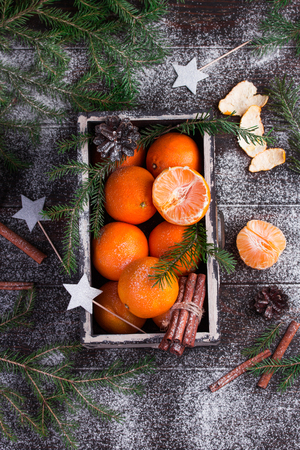 Tangerine in wooden box as christmas decoration