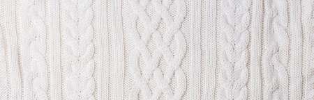 Warm white Knitted Items with Braids and Pattern Stockfoto