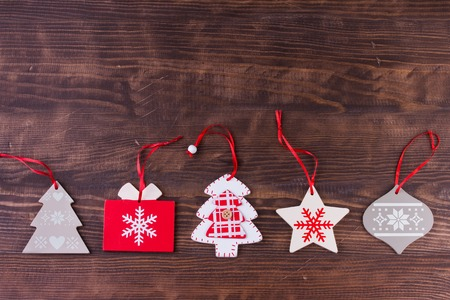 Christmas ornament flat lay on stained wooden