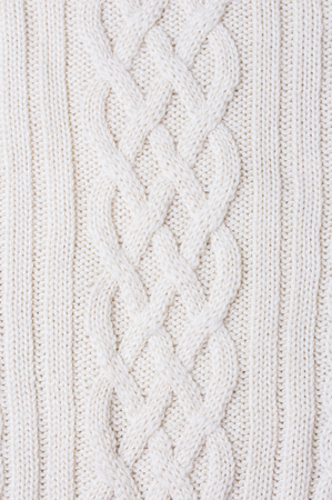 Warm white Knitted Items with Braids and Pattern 写真素材