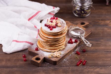 American pancakes with fresh berries on wooden 写真素材