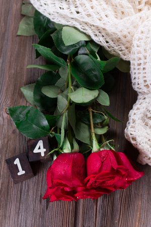 Red roses on wooden planks. Stock fotó
