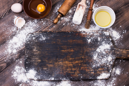 Rolling pin and flour on old wood table. Copy space. Top view. Flat lay Stock fotó