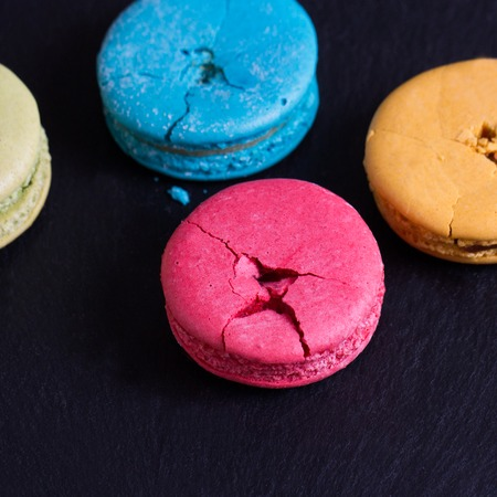 French assorted macarons cakes on a black Stock Photo