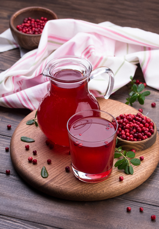Fresh cranberry drink on wooden