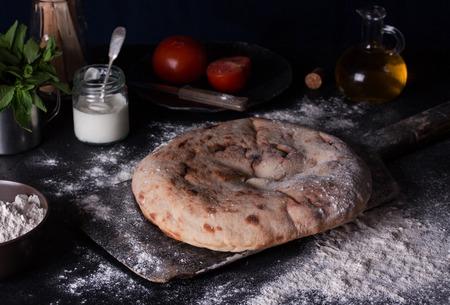 Lavash, the traditional Georgian flatbreads on the table. Georgian cuisine. Stock Photo