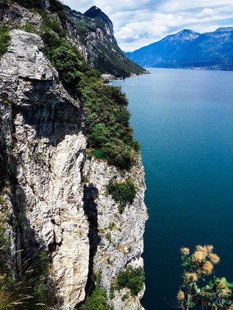 Panorama of the gorgeous Lake Garda surrounded by mountains, Italy.
