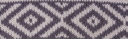 Grey knitted fabric.