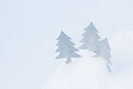 Three Abstract Christmas tree in snowdrift. 版權商用圖片