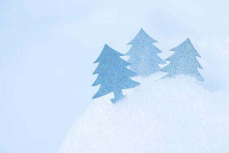 Three Abstract Christmas tree in snowdrift