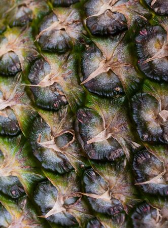Ripe Pineapple fruit texture. Pineapple skin closeup. For food and beverage, healthcare, abstract and diet and nutrition concepts.