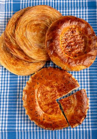 Homemade circle bread and Turkish flaky pastry (katmer)