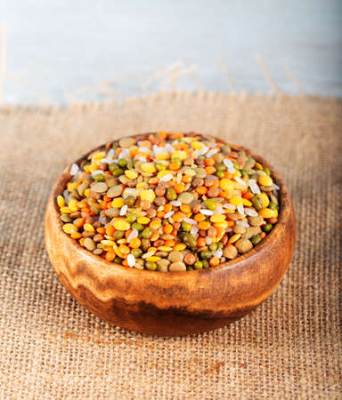 Colorful various beans or lentils and whole grain seeds or cereal in bowl