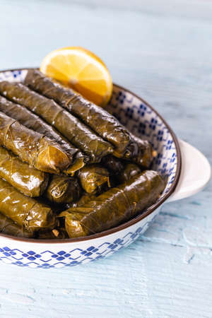Stuffed vine leaves with lemon/sarma/dolma from Turkish and Greek cuisine.
