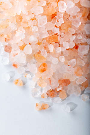 Pink Himalayan salt. Himalayan salt pile. Food background. Close up. Stock Photo