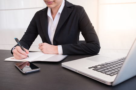 working woman: Bussiness woman working on working table Stock Photo