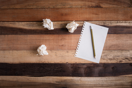 scarp: writing paper scarp of paper and pencil on wooden table Stock Photo