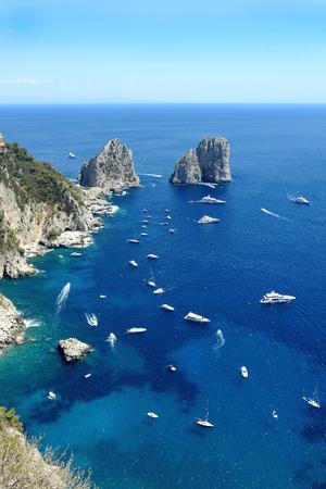Famous Faraglioni cliffs, Capri island, Italy Stock Photo