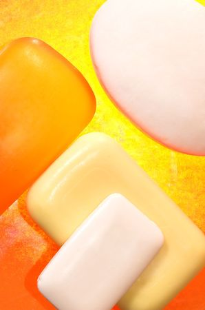 lye: Pieces of soap on a yellow background