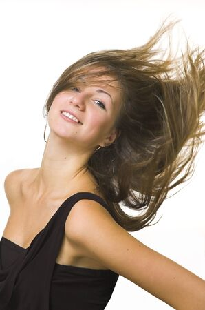The beautiful girl with fluttering hair Stock Photo