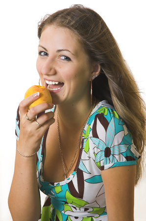 The young girl with a peach Stock Photo - 1623468