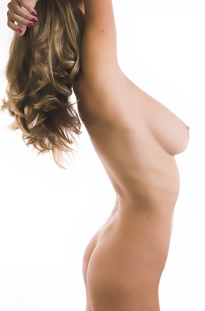 The beautiful naked body of the woman on a white background Stock Photo