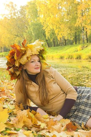 Portrait of the girl in a wreath from maple leaves Stock Photo - 1831604