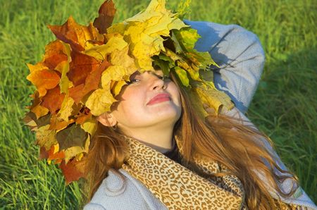 Portrait of the girl in a wreath from maple leaves Stock Photo - 1831606