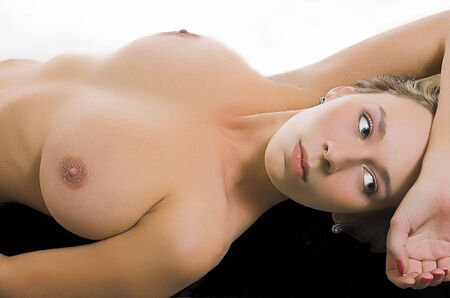 The beautiful naked girl lays on a white background Stock Photo