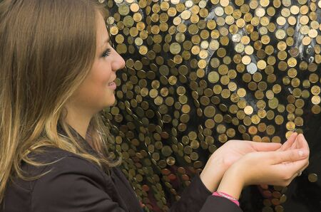 The happy girl and coins close up Stock Photo - 2005199