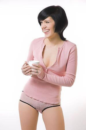The beautiful girl in pink linen with a cup in hands photo