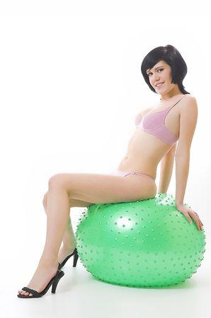 The beautiful girl in bikini and fitness-sphere photo