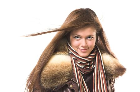 A smiling beautiful girl in winter clothes photo