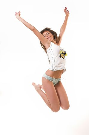 The happy girl jumps in underwear Stock Photo - 2159496