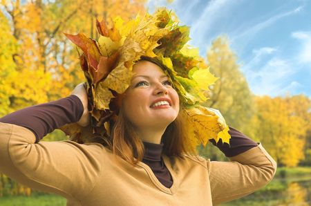 Portrait of the girl in a wreath from maple leaves