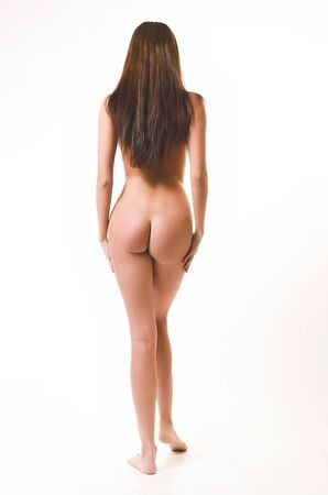 feet naked: The beautiful naked girl costs on a white background