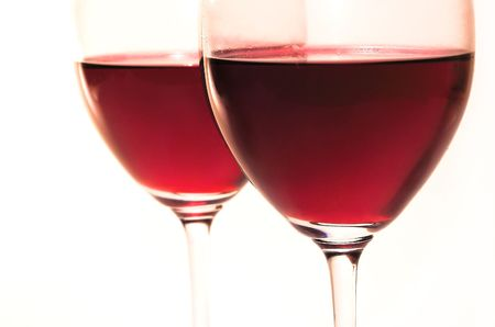 Two glasses with red wine close up photo