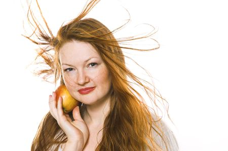 The beautiful girl with an apple on a white background photo