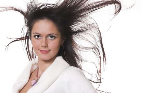 The beautiful brunette with in flying hair photo
