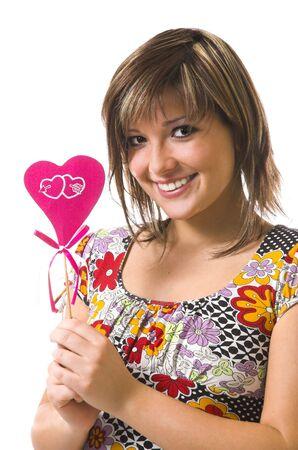The beautiful cheerful girl and heart photo