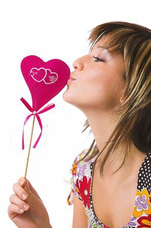 The beautiful cheerful girl and heart