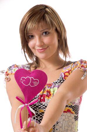 The beautiful cheerful girl and heart Stock Photo - 2250950