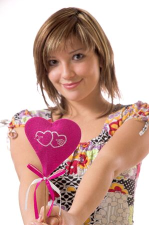 The beautiful cheerful girl and heart Stock Photo - 2250950