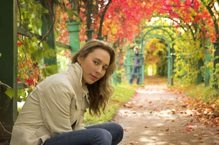 The beautiful blonde in red leaves of grapes Stock Photo - 2251017