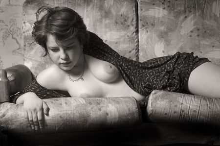 The beautiful naked girl on a sofa photo