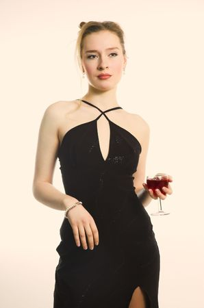 The beautiful woman with a glass of red wine photo