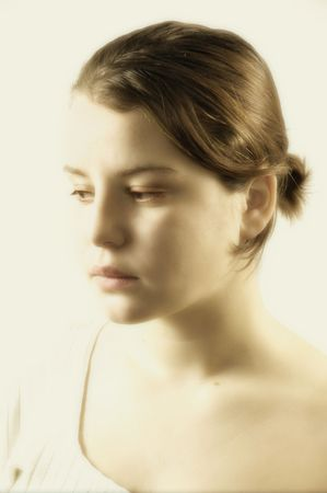 Portrait of the beautiful girl in light tones photo