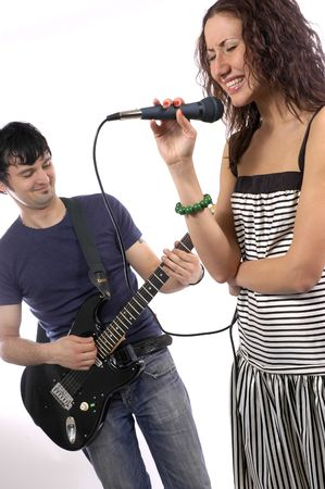 The man with a guitar and the woman with a microphone photo