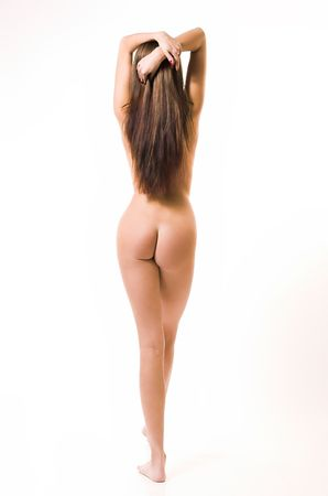 The beautiful naked girl costs on a white background Stock Photo - 2580568