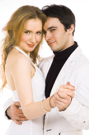 The man and the woman dance in white clothes